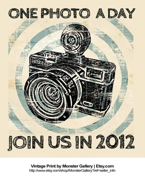 {A Photo a Day} It is possible. Will you join us in 2012? *Loved the vintage camera poster from Monster Gallery on Etsy.