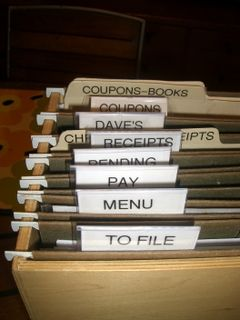 Tips for organizing the endless stream of paper, mail, flyers, etc. that accumulate...somewhere.  For us there's a pile in the back cabinet and the front door.