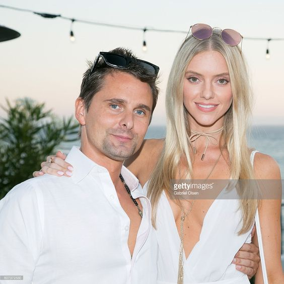 Matt Bellamy of Muse (L) and girlfriend Elle Evans (R) attend the Treats…:
