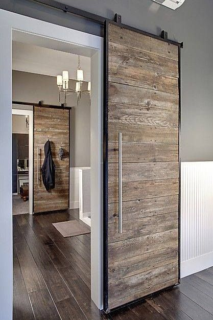 Sliding wooden doors is a great way to add rustic to a modern home. Love this interior design: