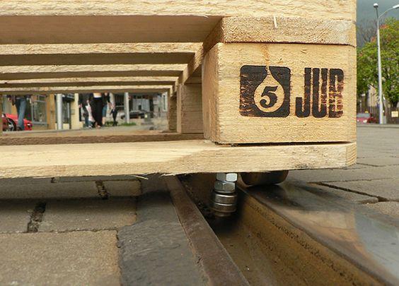 tomas moravec hacks a wooden pallet to glide down tram tracks