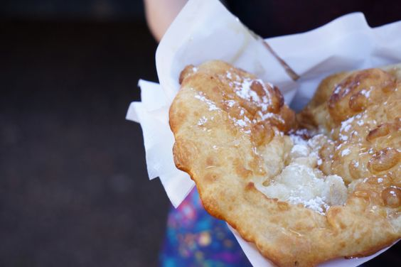 Indian Fry Bread with honey and powdered sugar on top, yes please!