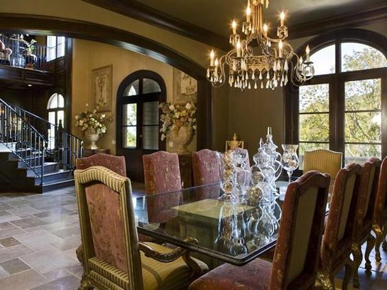 The tuscan style villa features a formal dining room a for Wine themed dining room ideas