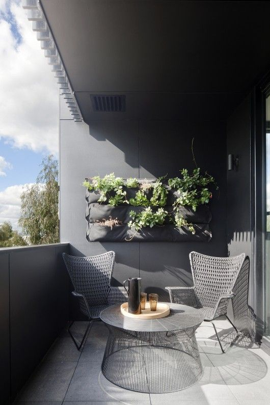 Shaded Modern Balcony with Simple Plant Wall