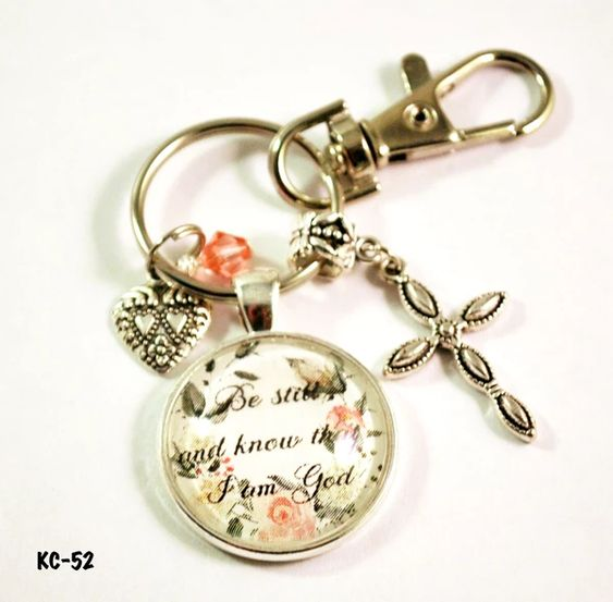 Inspirational Christ Keychain To help you remember to be still and know that He is God,  this bible verse keyring serves to hold your keys or can be clipped to your purse. It can even be hung from your rear view mirror. This inspirational keyring will remind you to let it go and let God be God.  It consists of handmade