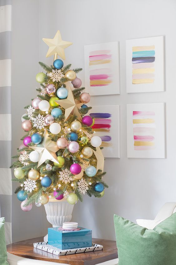 Sometimes it's nice to keep things traditional. This blogger topper her mini tree with a familiar star and hung colorful ball ornaments on each branch.  See more at Cuckoo 4 Design »   - HouseBeautiful.com