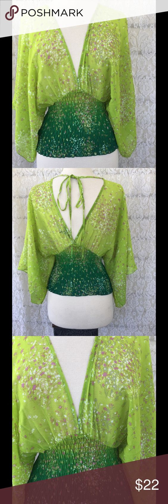 Boho Chic Green Apple Floral Blouse NWOT Deep v neck top. Clenched and stretchy waist. Open in the back as seen in picture two. Please ask any questions below & I always consider offers! Tops Blouses