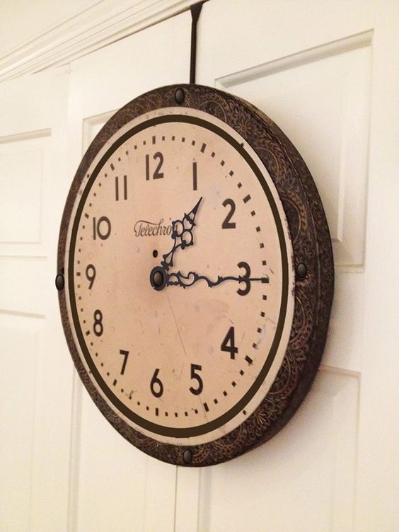 French Railroad Style Clock: found vintage clock face framed on salvaged antique tin ceiling tile, hand-pressed around a birch wood backing. Created by designer Stephanie Reppas. Coming soon, October Design Co.