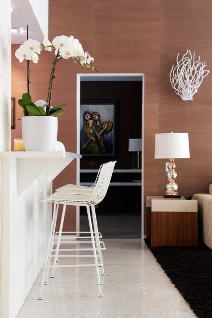 love love love---the stools and the coral-like sculpture on the wall