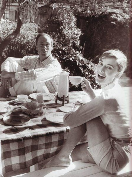 Audrey Hepburn having afternoon coffee outside.