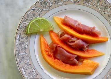 Slices of fresh papaya served with thinly sliced prosciutto and fresh squeezed lime.