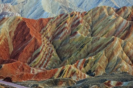 Rainbow Mountains in China. Pictures a  trip to China in  2014. Amazing area with unique colours in the nature. The formation of Zhangye Danxai Landform dates back to 6 million years ago. The Danxia geological structure was formed by the erosion of red sandstone, forming the isolated peaks and steep outcrops. Its special geological structure, combined with long-term weathering, freeze-thaw peeling, and wind and water erosion gave rise to its present appearance.  Photo by Jon Hilmarsson