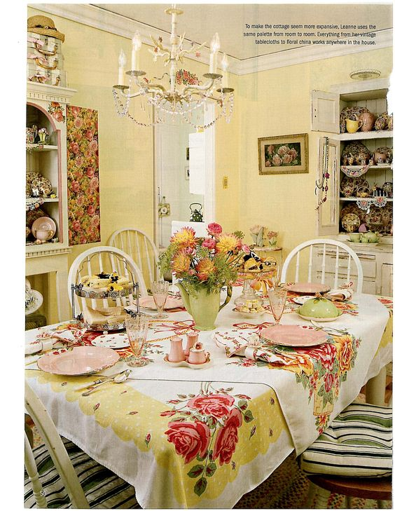 The vintage tablecloths layered are clever & add a lot of color & personality. Cheerful room.
