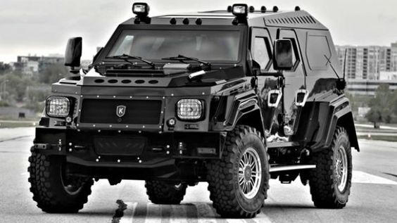 My $300,000 vehicle.  Twice the size of a Hummer, fully armored truck with opaque bullet-proof glass with ballistic run-flat tires. Runs on bio-diesel. Has night-vision surveillance cameras and an external listening device and a high-power roof-mounted spotlight. Interior is upholstered in leather, comes with a flat-screen TV, refreshment bar and satellite TV.   Only 100 made.