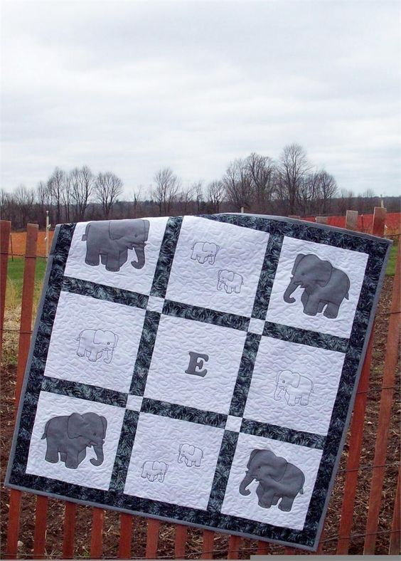 E is for Elephant Quilt Pattern will make a cute blanket or wall hanging for a baby or toddler.  Templates included!  Pattern available at http://quiltwoman.com/E-Is-For-Elephant-Quilt-Pattern.aspx#