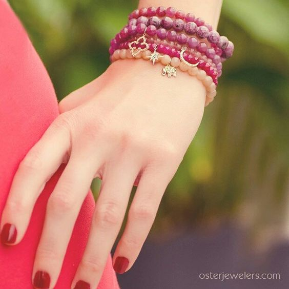 Triple wrap bracelet strung with 8 and 6mm faceted ruby beads & diamond charms. Perfect for stacking. #rubies #stretchbracelets #ilovejewelry #beadbracelets #jewelrygram #denverjewelers #osterjewelers Shop more beaded bracelets on osterjewelers.com