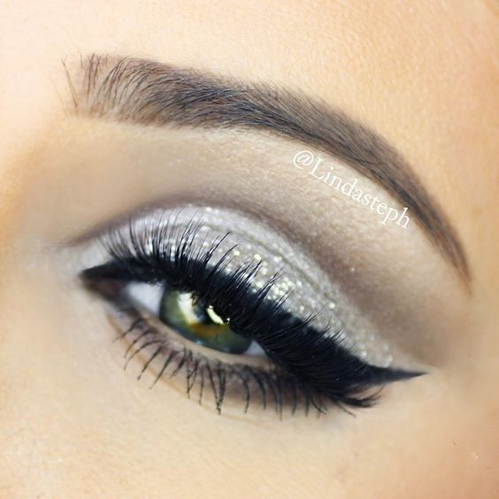 Silver glitter eyes with dramatic winged liner #eyes #eye #makeup #metallic #dramatic: