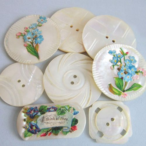 Beautiful grouping of antique MOP buttons with carving and delicate hand painting.