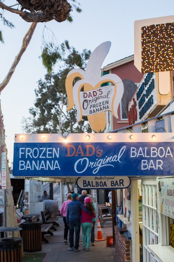 A Balboa Island staple - Dad's Donut & Bakery Shop is famous for their Balboa Bars and frozen bananas -- read the full Newport Beach neighborhood guide to get our full list of must-dos in the area!