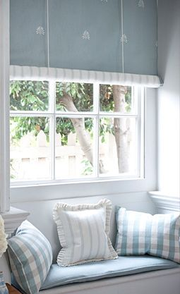 These are my colors...pale blue and white. And I love the Swedish blinds.