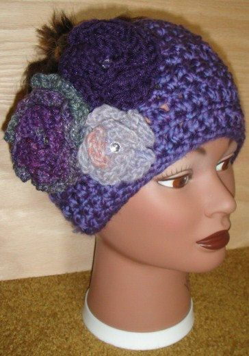 purple headband with flowers and accent crystals by adamkhloe, $15.00