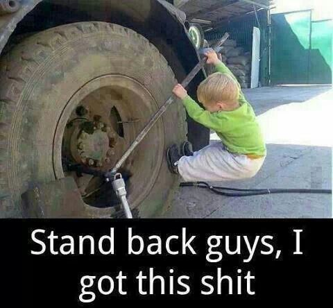 Kid fixin a tire