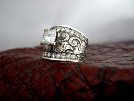 Custom made western wedding rings by Travis Stringer. Contact us on FaceBook. (Ring #51)... I'm impressed and that says something if it regards talking about weddings. I really really want this!!!!!!  That would be perfect!!! Minus the diamond in the middle.