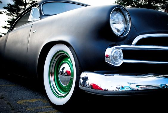 Flat black hot rod with sweet accent wheels.