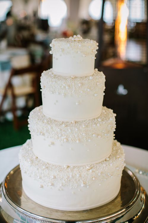 a simple, classic wedding cake. the pearls on top look a little silly, but it's such a beautiful cake.