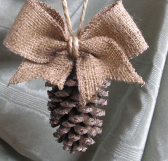 In love with this!!  Add some white paint to add some snow effects - must try!  Pinecone Tassel / Ornament with burlap bow/NEW by pineconeshoppe, $5.00: