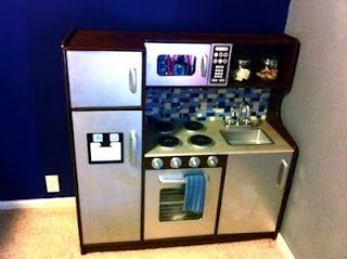 """DIY kitchen.. designed for BOYS! See the """"stainless steel""""... it's metallic silver spray paint!! The granite counters? It's stone spray paint! The full instructions are included. This looks nicer than my actual kitchen! ;-)"""