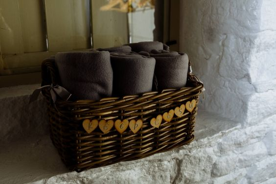 Cosy fleece blankets for guests. Winter wedding details. Yorkshire wedding photographer: