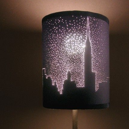 Stencil, then poke small holes in a dark lampshade to make a picture. NEAT! I want this lamp!!