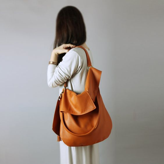 TUULI is a soft big hobo bag in orange cognac natural leather.  This slouchy hobo made of soft and beautiful, finest italian calfskin leather in orange