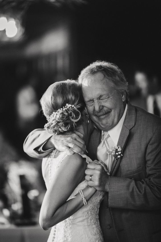 bride hugging her father