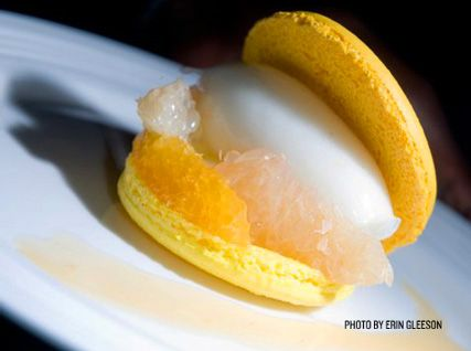 citrus macarons with citrus slices, lime–vanilla sorbet, lemon curd cream, and blood orange sauce.