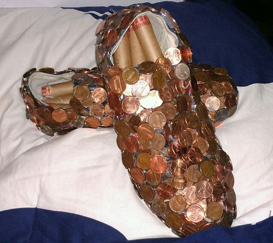 Two old shoes covered in pennies, cover shoe box in pennies too if you have the time