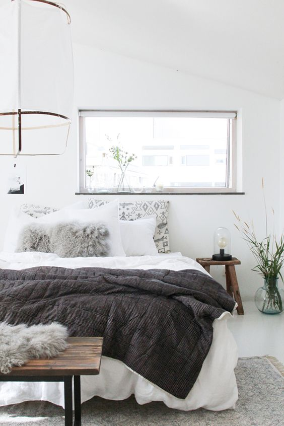 This stunning bedroom reflects the Danish trend of making their homes into hygge havens, with their heavy wood, leather and cosy sheepskin rugs and throws. More: