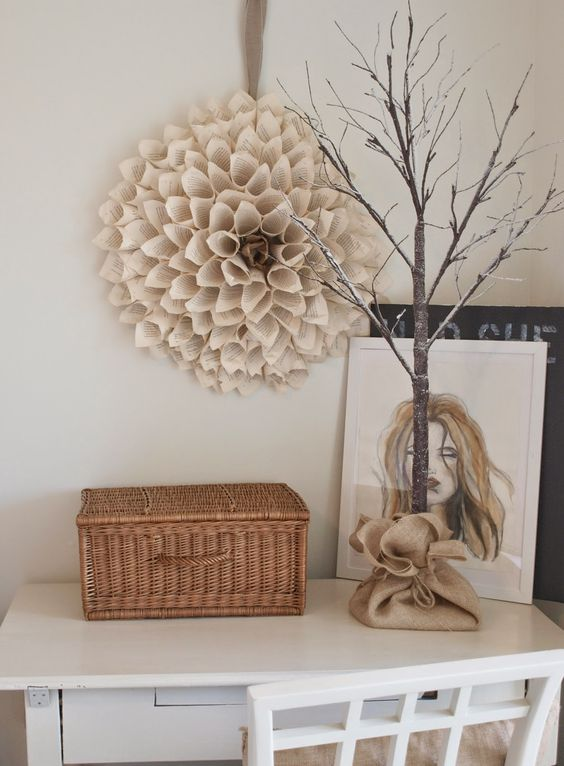 A DIY paper cone wreath, acrylic painting, and tree on a white painted desk/Hello Lovely Studio/vignette of neutrals