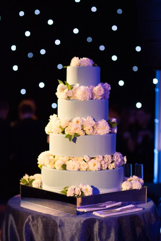 Blue is our favorite color, and aside from it being the main color selection for most aspects of the wedding, we were also intent on having a blue cake with chocolate inside. Cheryl Kleinman made our cake and the Stark team decorated it with fresh white flowers.