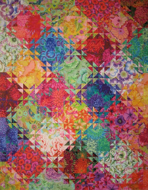 Shimmering Triangles in all Kaffe Fassett fabrics from www.allaboutcolorquilting.com