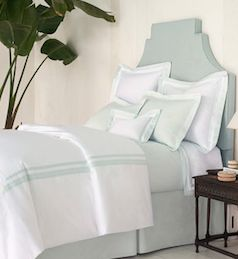 Light blue bed with light blue bed sheets
