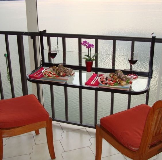 Fold down table for a small balcony. Great idea. How To Decorate A Balcony In An Apartment: