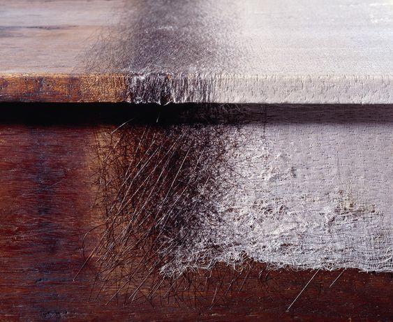 Doris Salcedo. Unland: the orphan's tunic (detail), 1997. Wooden tables, silk, human hair, and thread. Photo: David Heald