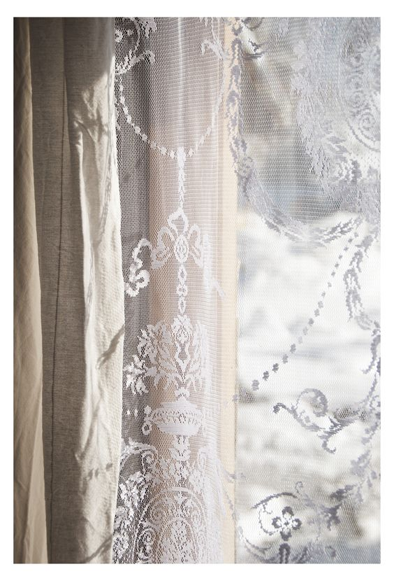 Would love to do lace curtains with a navy colored curtain over it ...