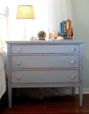 Soft blue antique dresser with new glass pulls
