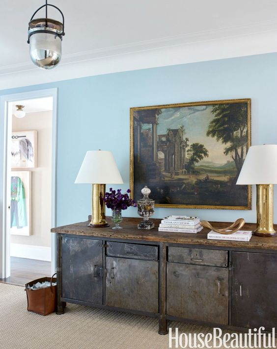 To soothe city-frayed nerves, the front door opens to entry walls painted in Benjamin Moore's Palladian Blue.: