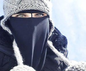 Niqabi in the snow                                                                                                                                                     More