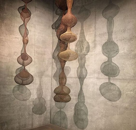Hanging wire basket creations by Ruth Asawa
