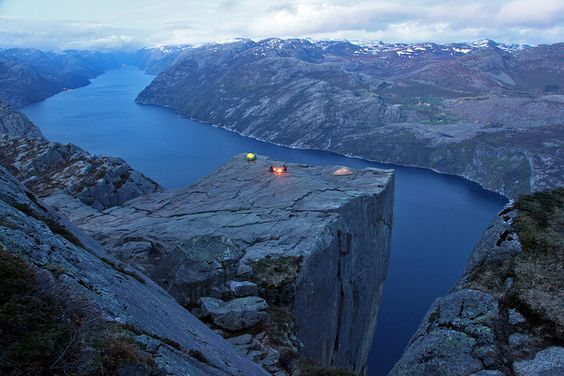 Hikers camping out on the famous cliff of Preikestolen in Norway.